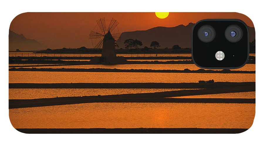 Environmental Conservation IPhone 12 Case featuring the photograph Sunset Over The Saltpans And A Windmill by Dallas Stribley
