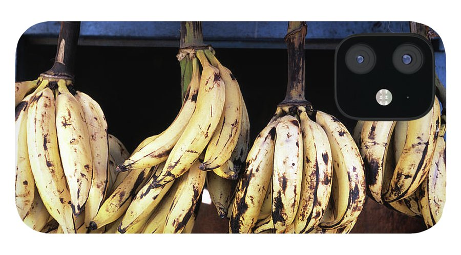 Hanging IPhone 12 Case featuring the photograph Tanzania, Zanzibar, Bananas For Sale In by John Seaton Callahan