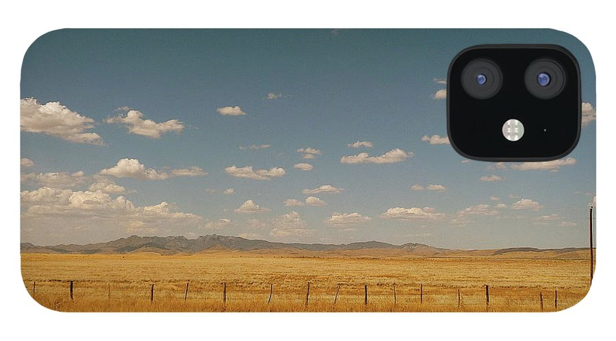 Tranquility IPhone 12 Case featuring the photograph Texan Desert Landscape And Rail Tracks by Papilio