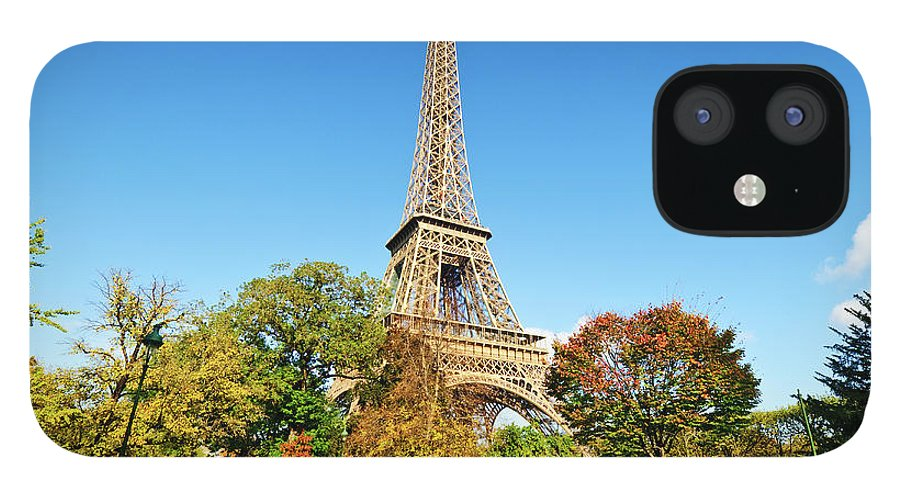 Clear Sky IPhone 12 Case featuring the photograph The Eiffel Tower With Some Autumnal by Tom Bonaventure