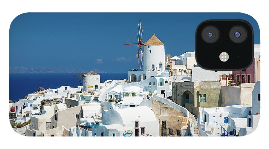 Greek Culture IPhone 12 Case featuring the photograph The Small Greek Village Of Oia by Sylvain Sonnet