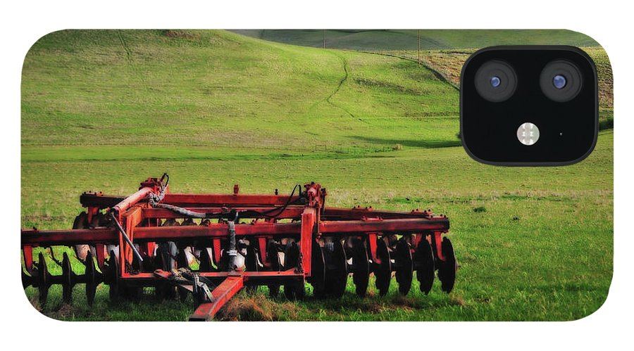 Working iPhone 12 Case featuring the photograph Tractor Blades On Green Pasture by Mitch Diamond