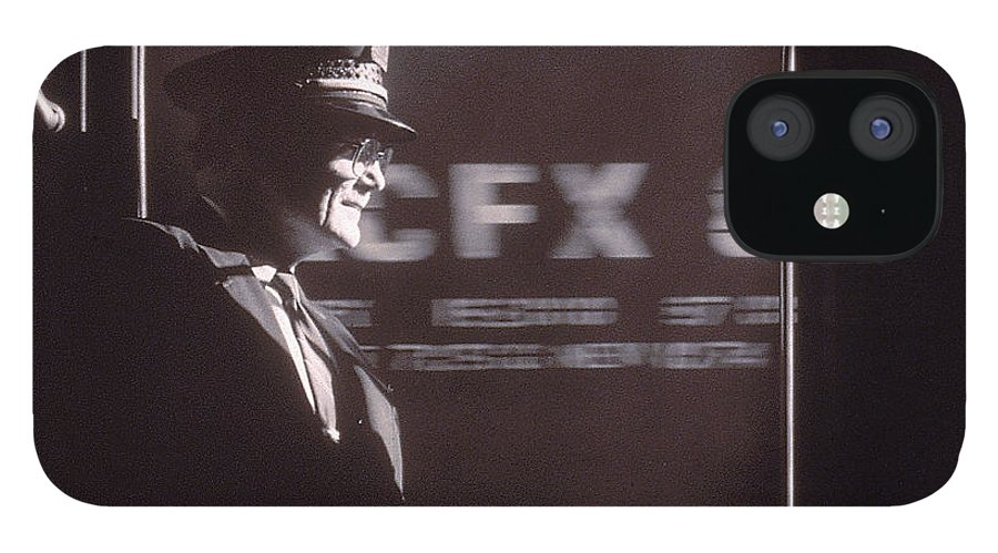 Working IPhone 12 Case featuring the photograph Train Conductor Looking Out Of Window by John Coletti