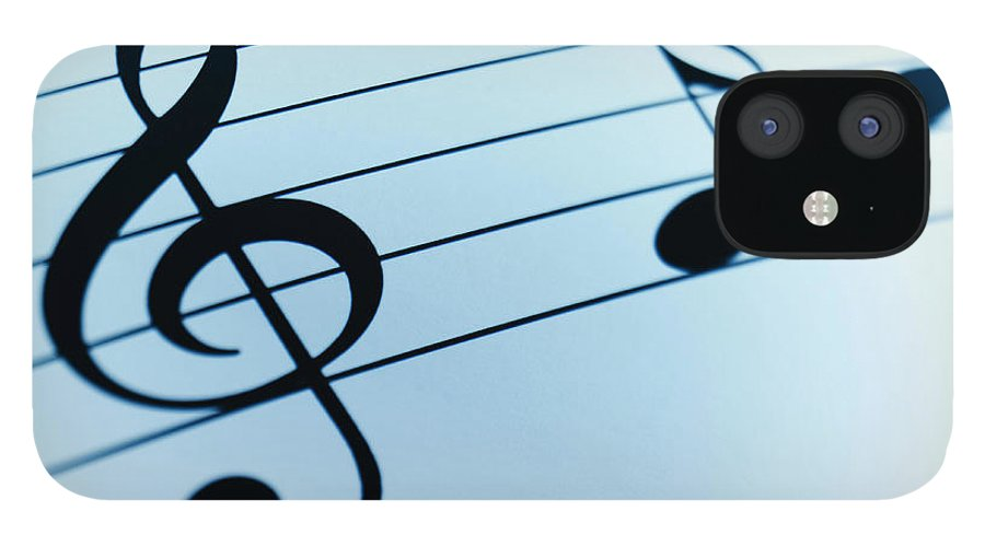Sheet Music IPhone 12 Case featuring the photograph Treble Clef And Notes by Adam Gault