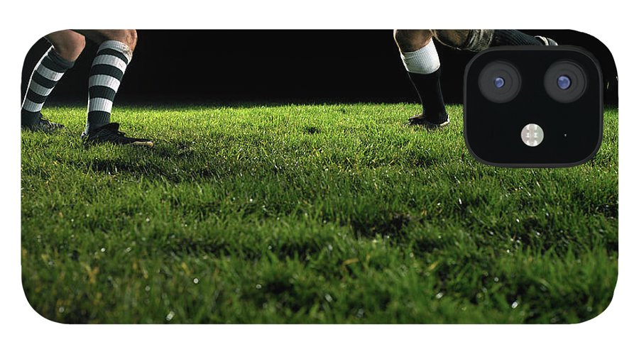 Grass IPhone 12 Case featuring the photograph Two Opposing Rugby Players, One Holding by Thomas Barwick