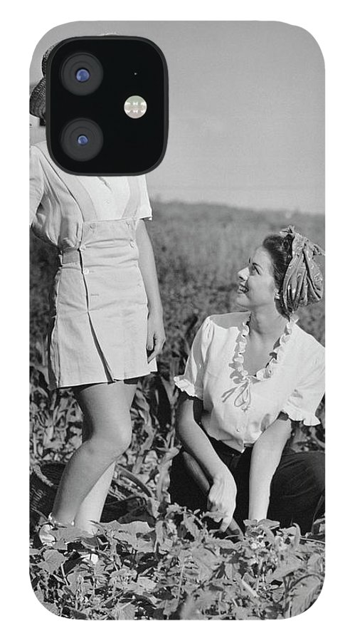 People IPhone 12 Case featuring the photograph Two Women Gardening In Field by George Marks