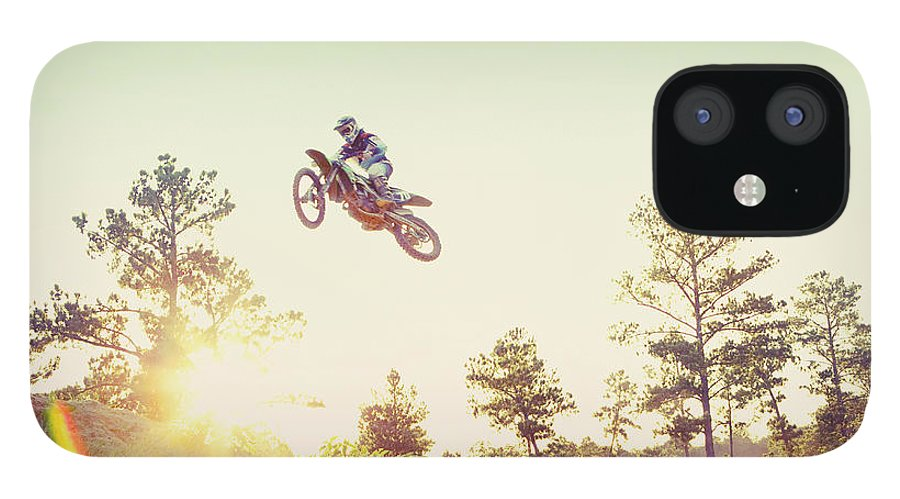 Recreational Pursuit IPhone 12 Case featuring the photograph Usa, Texas, Austin, Dirt Bike Jumping by Tetra Images - King Lawrence