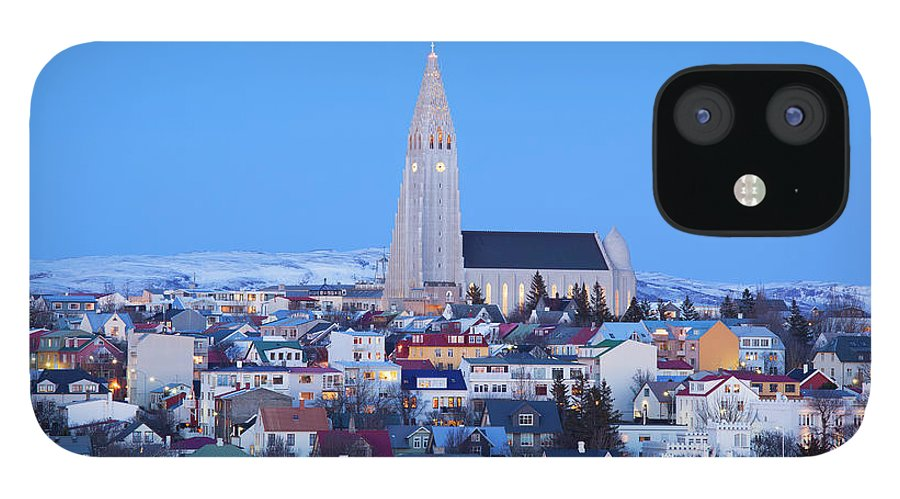 Snow IPhone 12 Case featuring the photograph View Of Hallgrimskirkja Church by Travelpix Ltd