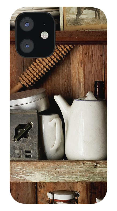 Bohuslan IPhone 12 Case featuring the photograph View Of Old Crockery In Flea Market by Johner Images