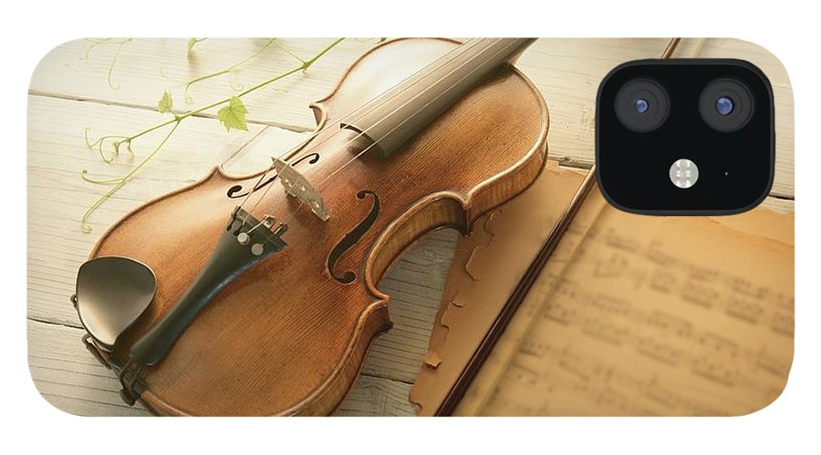 Sheet Music IPhone 12 Case featuring the photograph Violin And Music Sheet by Image Work/amanaimagesrf