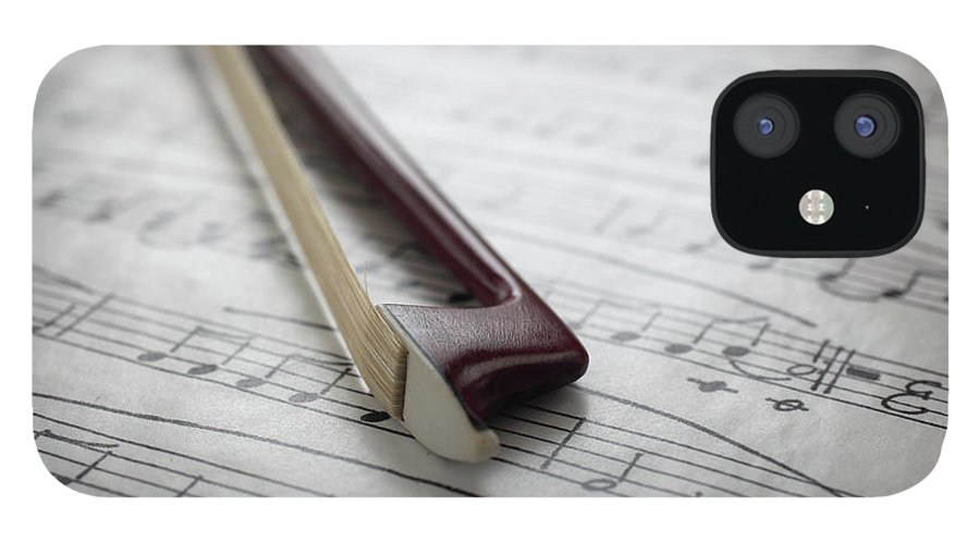 Sheet Music IPhone 12 Case featuring the photograph Violin Bow On Music Sheet by Daniel Allan