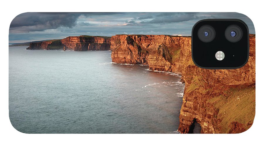 Scenics IPhone 12 Case featuring the photograph Waves Washing Up On Rocky Cliffs by George Karbus Photography