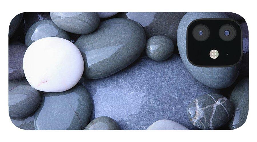 Large Group Of Objects iPhone 12 Case featuring the photograph Wet Granite Pebbles On Beach by Rosemary Calvert