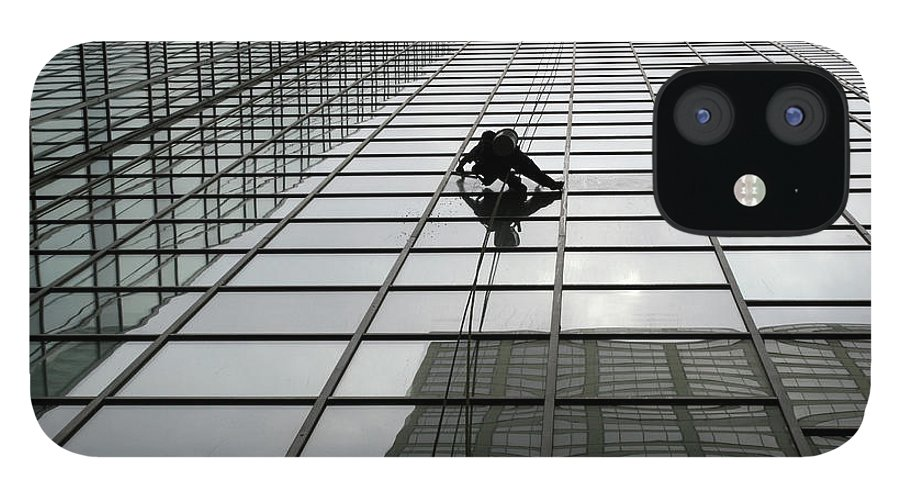 Working IPhone 12 Case featuring the photograph Window Washer by Filo