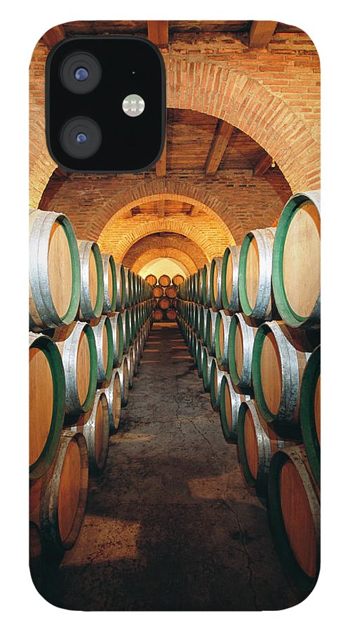 Working IPhone 12 Case featuring the photograph Wine Barrels In Cellar, Spain by Johner Images