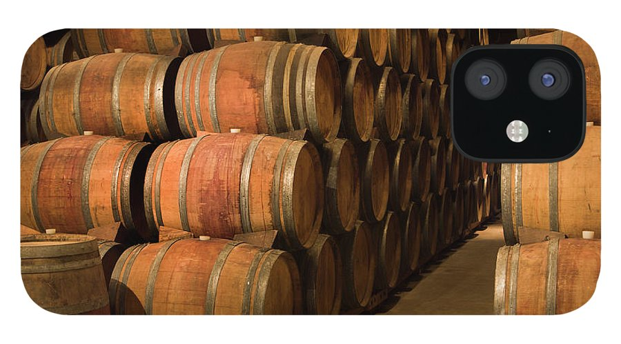 Fermenting IPhone 12 Case featuring the photograph Wine Barrels In Winery Cellar Of Napa by Yinyang