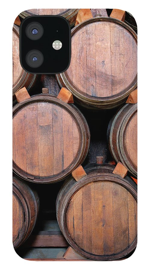Fermenting IPhone 12 Case featuring the photograph Wine Barrels Stacked Inside Winery by Yinyang