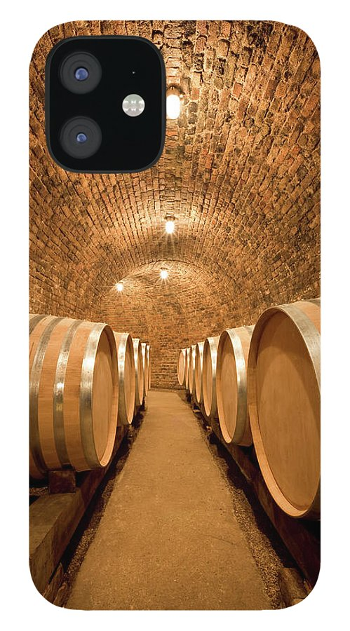 Aging Process IPhone 12 Case featuring the photograph Wine Cellar With Large Barrels by Benedek