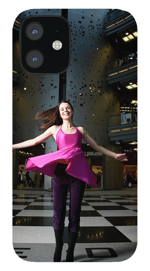 People IPhone 12 Case featuring the photograph Woman Dancing In Old Brewery Shopping by Tim E White