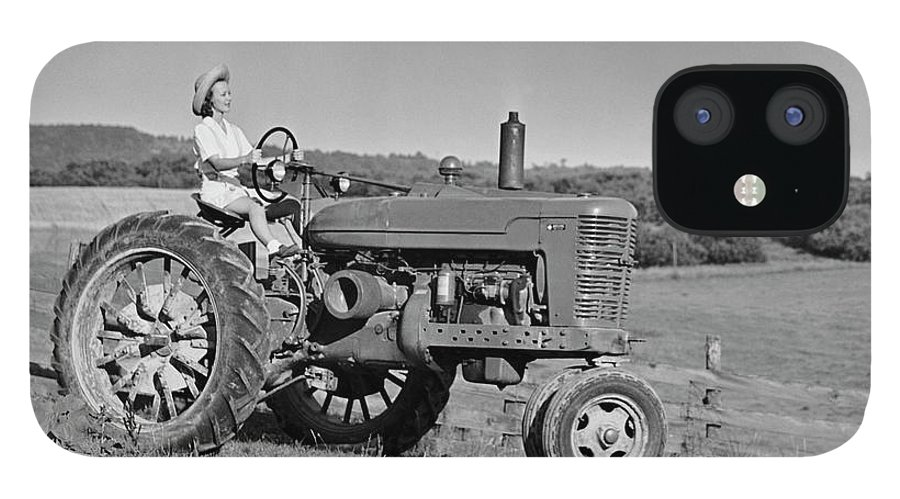 Working IPhone 12 Case featuring the photograph Woman Farmer Driving Tractor by George Marks