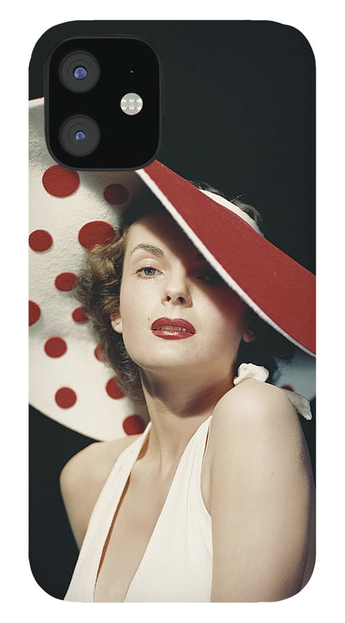 People IPhone 12 Case featuring the photograph Woman Wearing Large Spotted Hat by Tom Kelley Archive