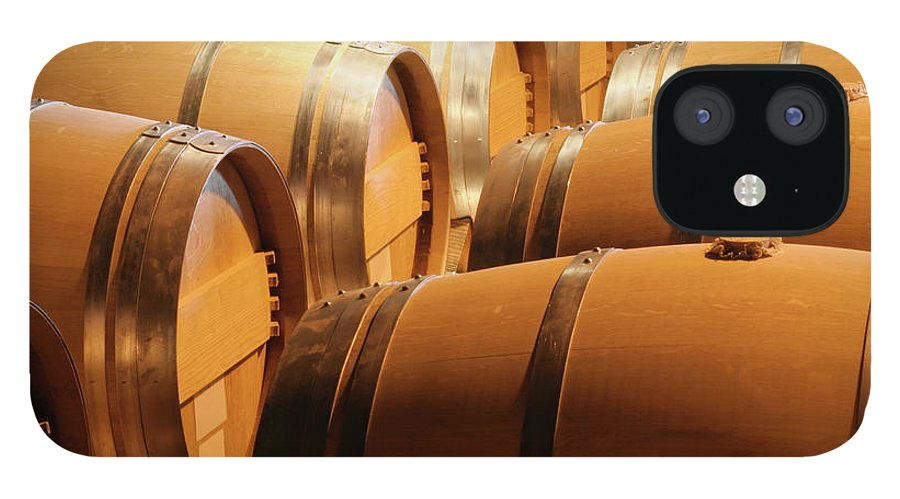 Fermenting IPhone 12 Case featuring the photograph Wood Wine Barrels In Winery Cellar In by Yinyang