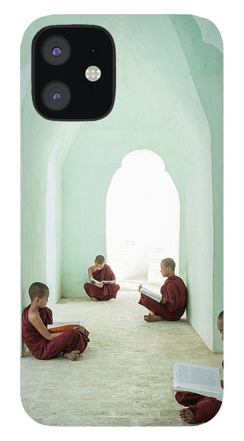Arch IPhone 12 Case featuring the photograph Young Buddhist Monks Reading In Temple by Martin Puddy