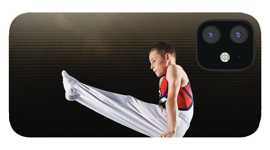 Focus IPhone 12 Case featuring the photograph Young Male Gymnast Performing On by Robert Decelis Ltd