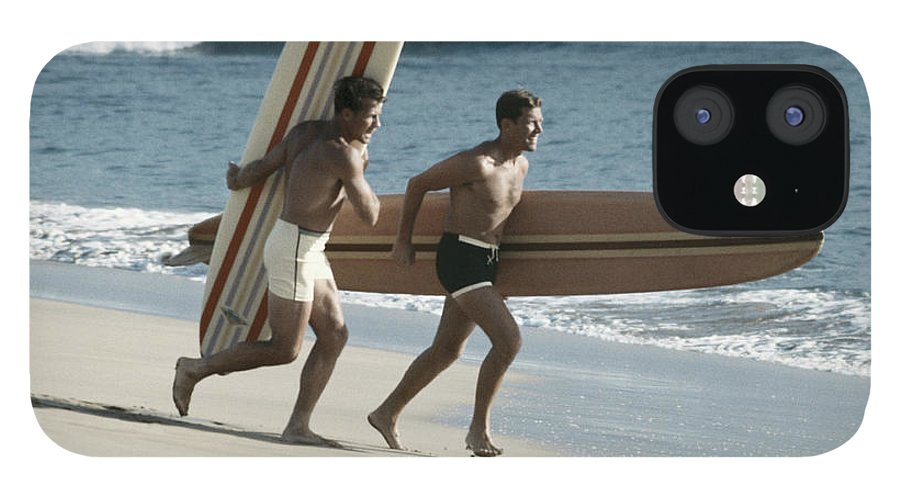 People IPhone 12 Case featuring the photograph Young Men Running On Beach With by Tom Kelley Archive