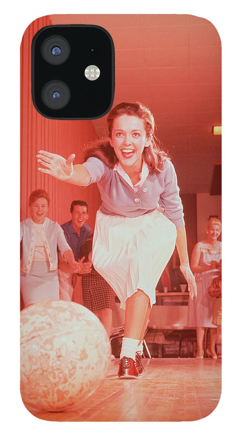People iPhone 12 Case featuring the photograph Young Woman Bowling, Family Watching In by Fpg