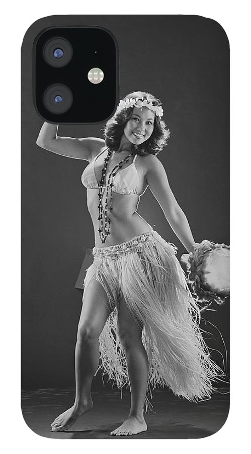 People IPhone 12 Case featuring the photograph Young Woman Hula Dancer With Feathered by Tom Kelley Archive