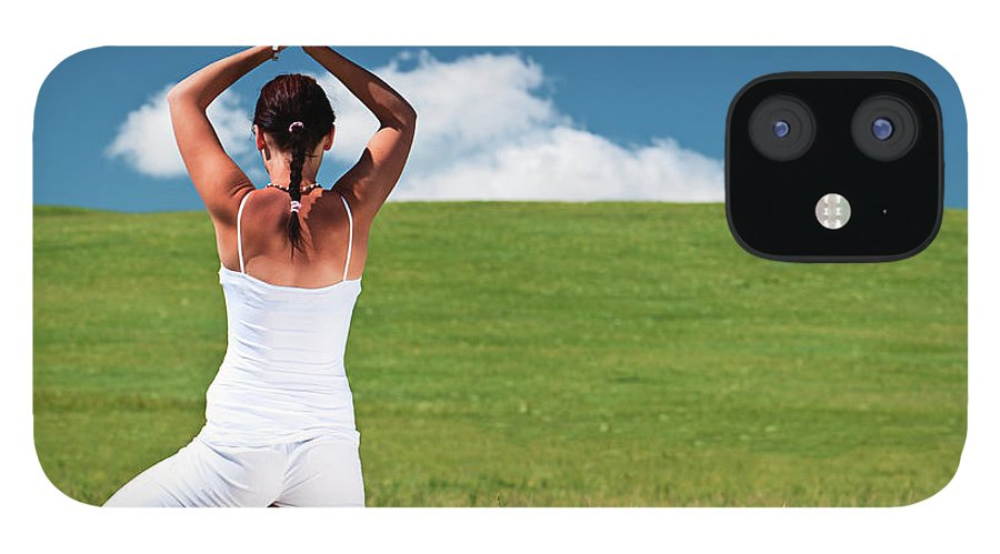 Scenics IPhone 12 Case featuring the photograph Young Woman Practicing Yoga by Hadynyah
