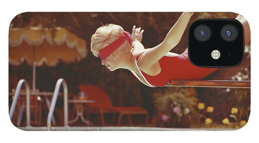 Human Arm IPhone 12 Case featuring the photograph Young Woman With Blindfold Balancing On by Tom Kelley Archive
