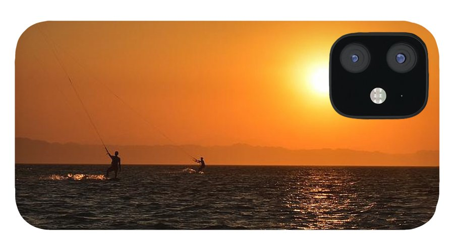 Kitesurfing IPhone 12 Case featuring the photograph Red sea sunset by Luca Lautenschlaeger