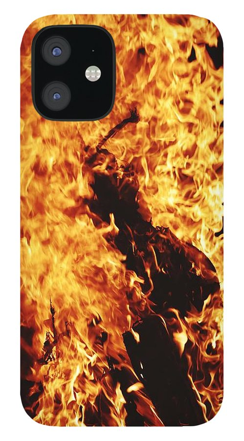 Campfire IPhone 12 Case featuring the photograph Closeup of Fire at time of festival by Ravindra Kumar