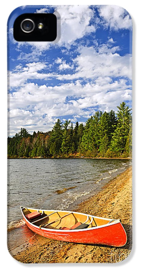 Canoe IPhone 5 Case featuring the photograph Red Canoe On Lake Shore by Elena Elisseeva