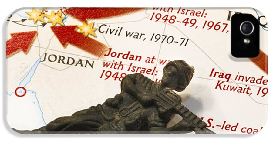 Aggression IPhone 5 / 5s Case featuring the photograph Army Man Lying On Middle East Conflicts Map by Amy Cicconi
