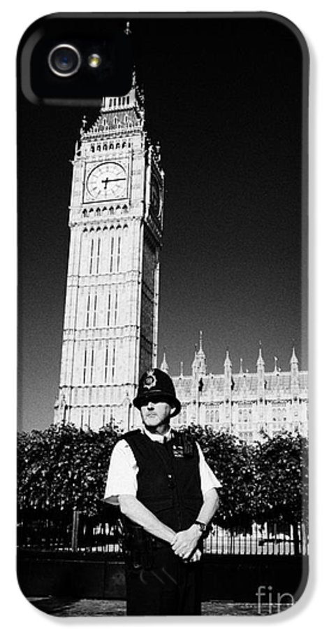 British IPhone 5 Case featuring the photograph british metropolitan police office guarding the houses of parliament London England UK by Joe Fox