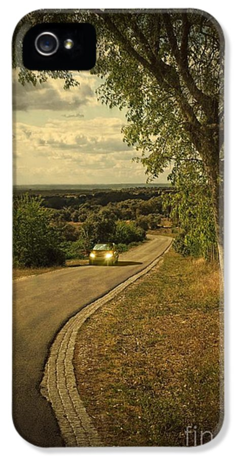 Mysterious IPhone 5 Case featuring the photograph Car On Road by Carlos Caetano