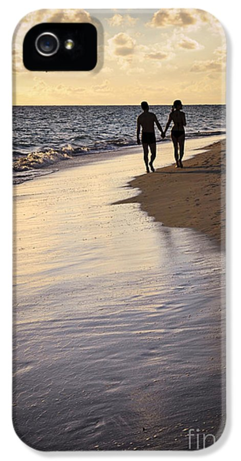 Couple IPhone 5 Case featuring the photograph Couple Walking On A Beach by Elena Elisseeva