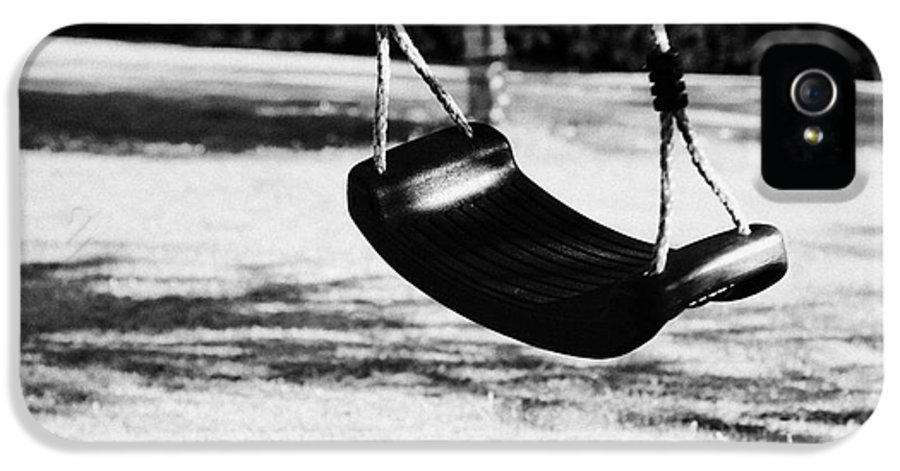Empty IPhone 5 Case featuring the photograph Empty Plastic Swing Swinging In A Garden In The Evening by Joe Fox