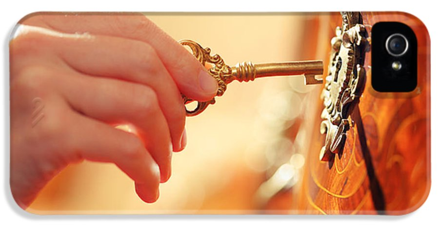 Key IPhone 5 Case featuring the photograph Hand With Key by Konstantin Sutyagin