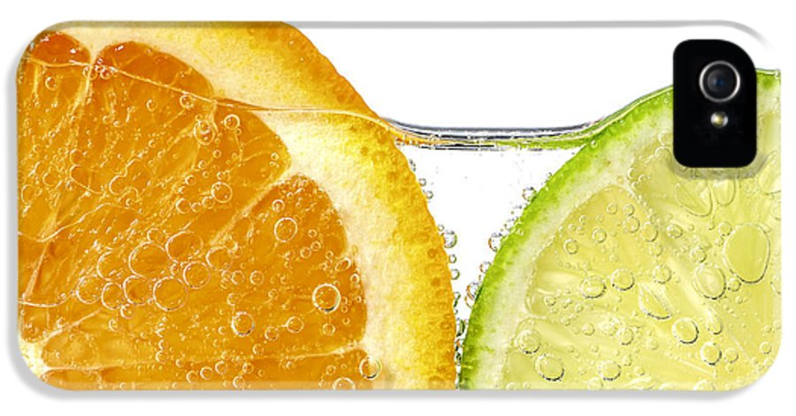 Orange IPhone 5 Case featuring the photograph Orange And Lime Slices In Water by Elena Elisseeva