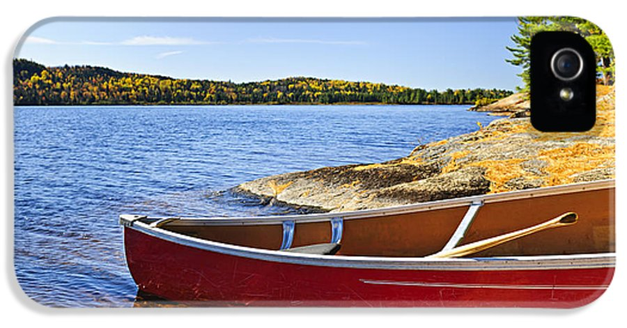 Canoe IPhone 5 Case featuring the photograph Red Canoe On Shore by Elena Elisseeva