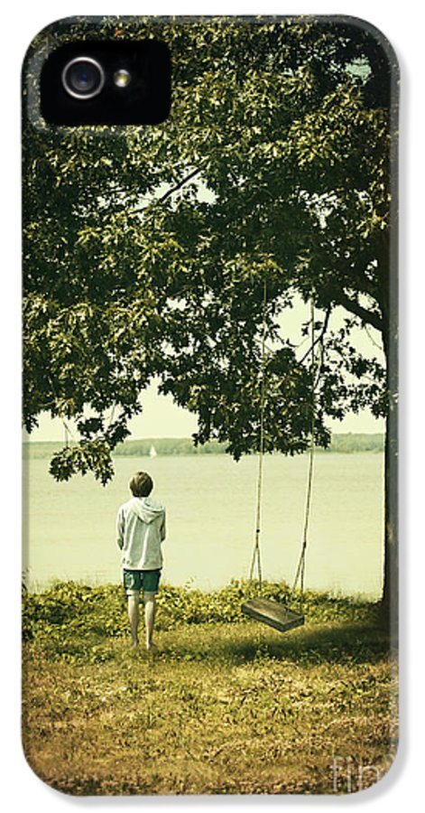 Atmosphere IPhone 5 Case featuring the photograph Young Boy Looking Out At The Water Under A Big Tree by Sandra Cunningham