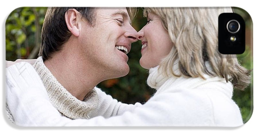 Human IPhone 5 Case featuring the photograph Smiling Couple Embracing by Ian Boddy