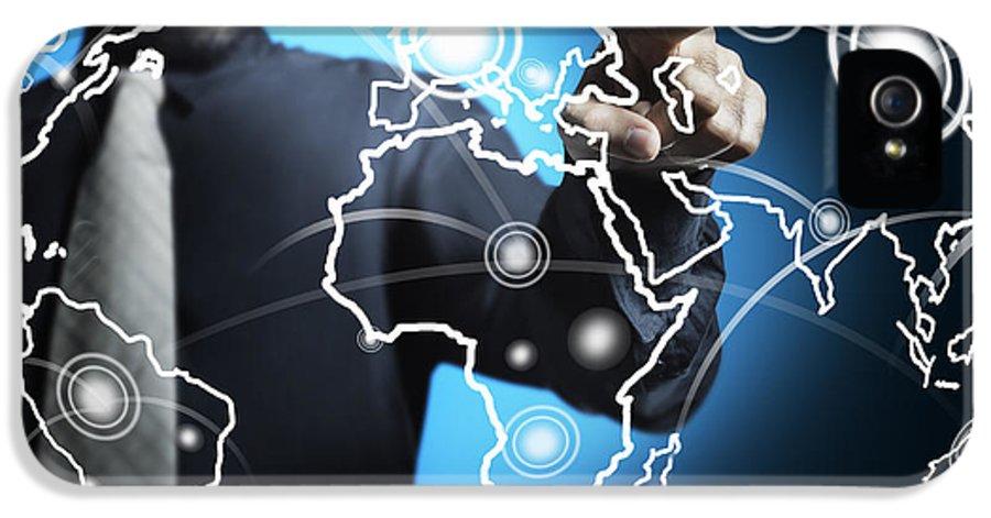 Business IPhone 5 Case featuring the photograph Businessman Touching World Map Screen by Setsiri Silapasuwanchai