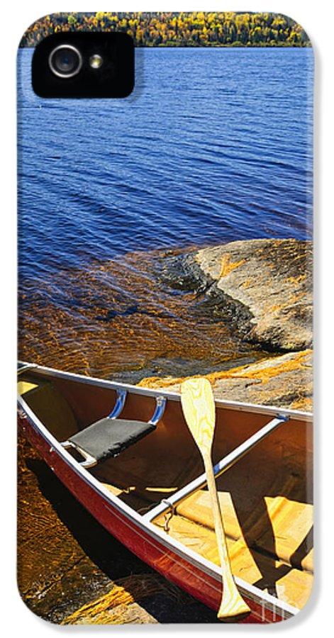 Canoe IPhone 5 Case featuring the photograph Canoe On Shore by Elena Elisseeva