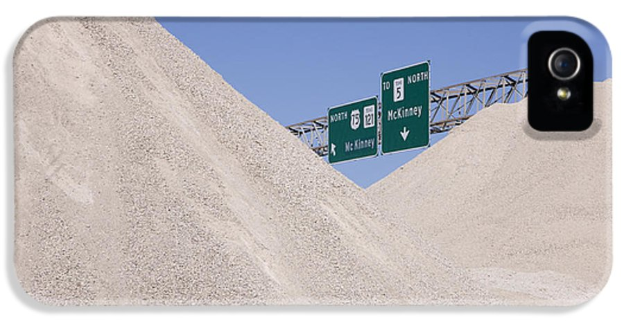 Copy Space IPhone 5 / 5s Case featuring the photograph Dirt Mounds With Highway Signs In Background by Jeremy Woodhouse