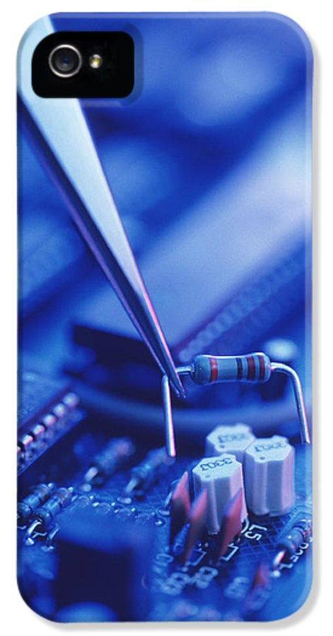 Circuit Board IPhone 5 Case featuring the photograph Forceps Holding A Resistor Over A Circuit Board by Chris Knapton